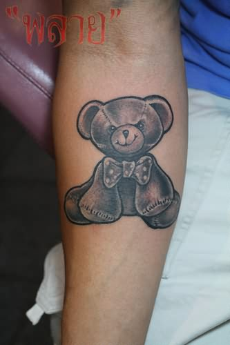 Teddy bear small tattoo on arm for Small bicep tattoos