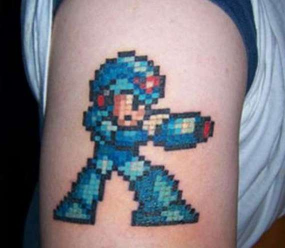 Animated Video Game Tattoo On Bicep