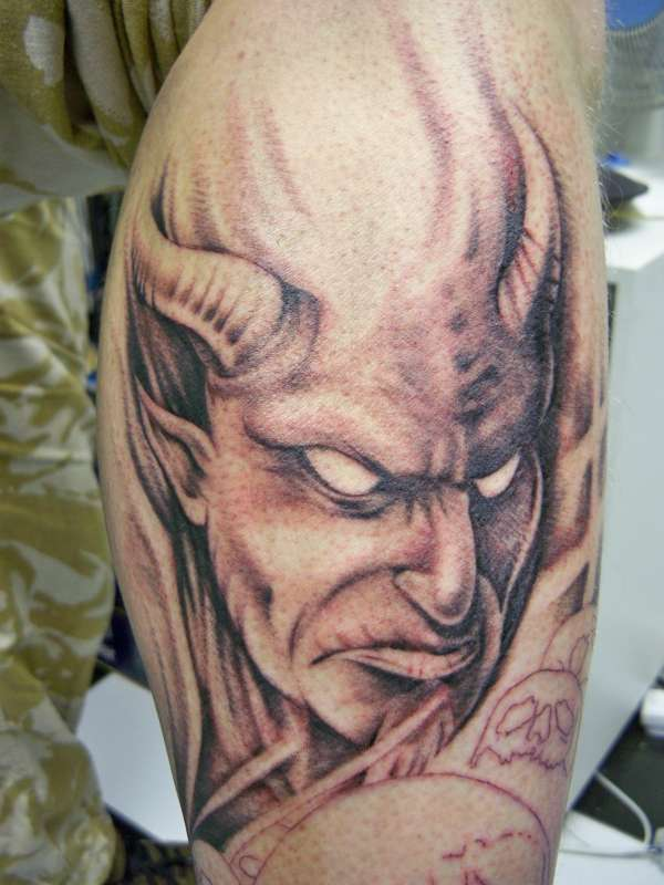 Grey Ink Devil Tattoo