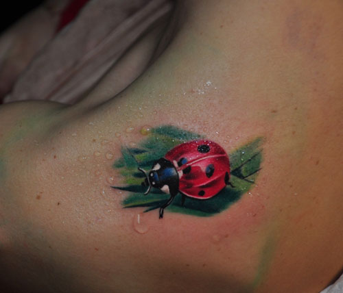 Ladybug On Green Leaf Tattoo On Upper Shoulder