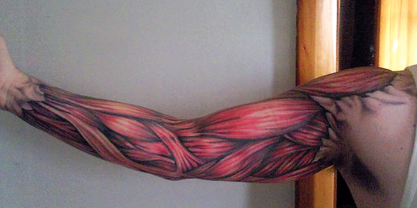 Red Muscles Tattoo On Man Right Sleeve