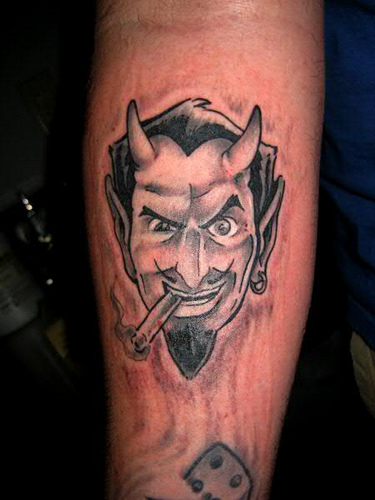 Smoking Devil Tattoo On Forearm