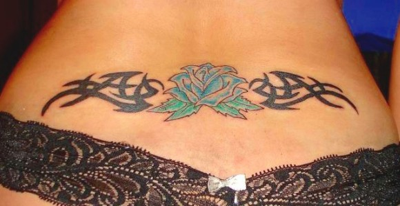 Tribal And Blue Rose Tattoo On Waist