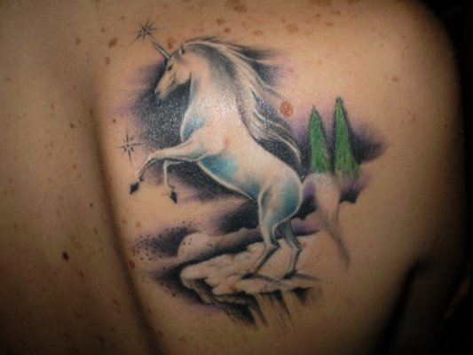 White Unicorn Tattoo On Back Shoulder