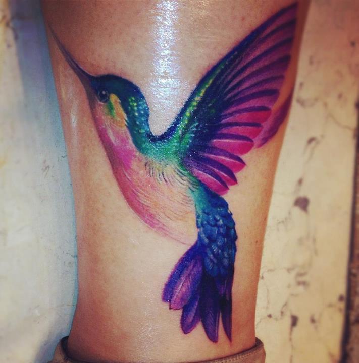 Color Hummingbird Tattoo On Leg Closeup Image
