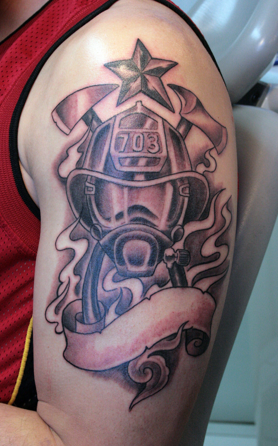 Grey Ink Firefighter Tattoo With Banner