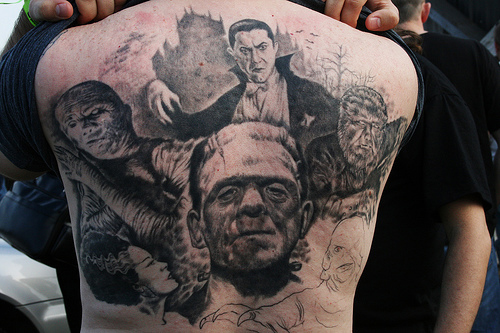 Grey Ink Horror Movie Tattoo On Back