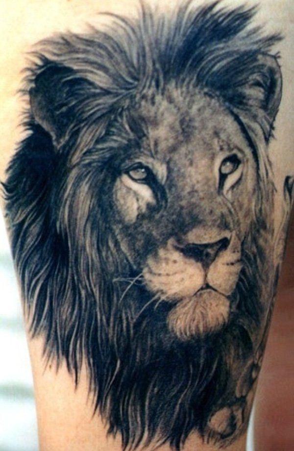 Grey Ink Lion Head Tattoo On Leg