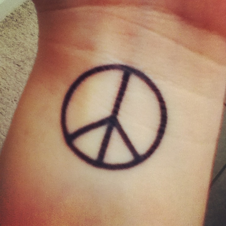 Peace Tattoo Images & Designs