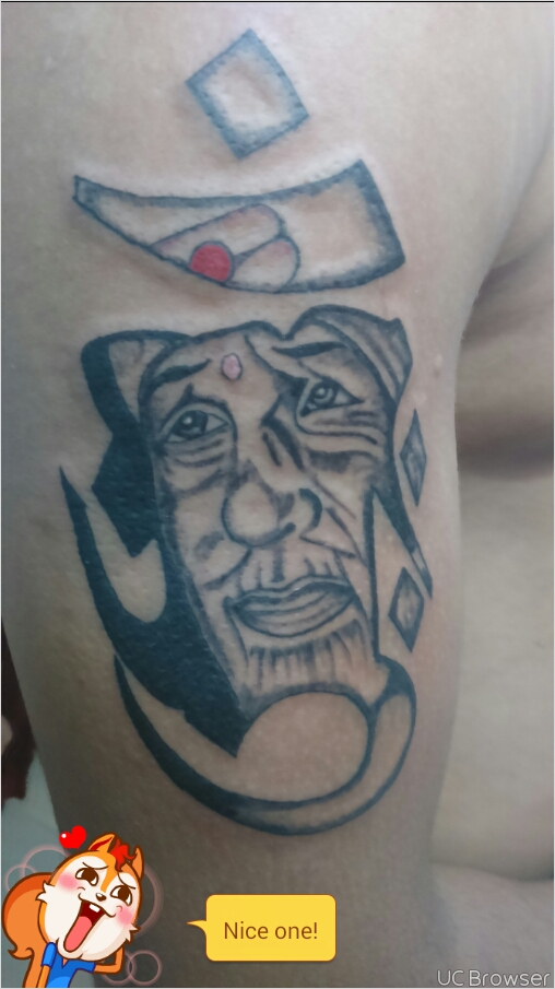 Sai Baba Lord Ganesha In Om Religious Tattoo