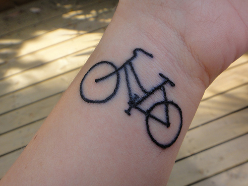 Black Outline Bike Tattoo On Wrist