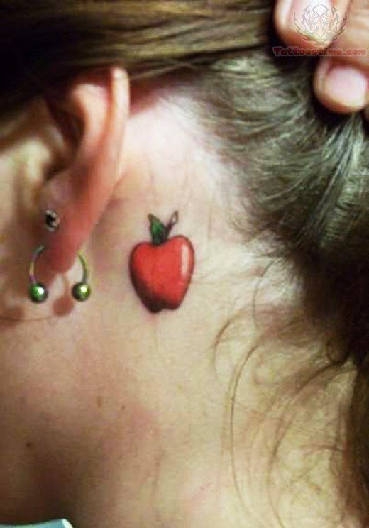 Cute Small Red Apple Tattoo Behind Ear by Ana Maranges Hackman