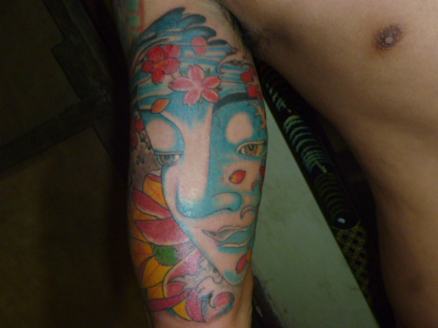 Color Ink Buddhist Tattoo On Half Sleeve