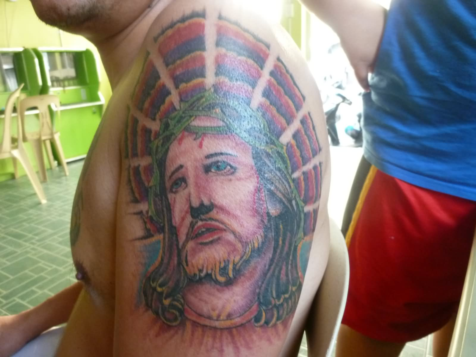 Jesus Head Tattoo On Left Shoulder