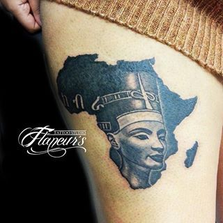 African Queen In Map Tattoo On Thigh