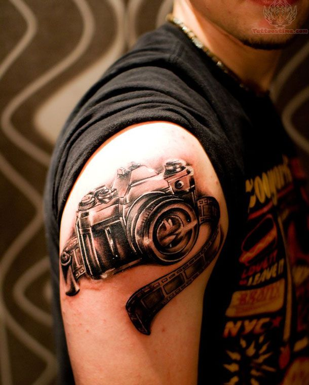 Black And Grey Camera Tattoo On Right Shoulder