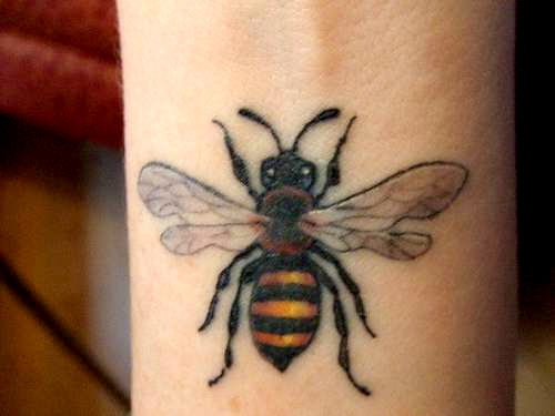Colored Bumblebee Tattoo On Left Wrist