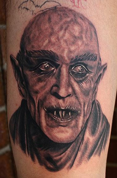 Creepy old horror movie monster tattoo on leg