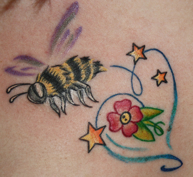 Cute Flower And Stars With Bumblebee Tattoo