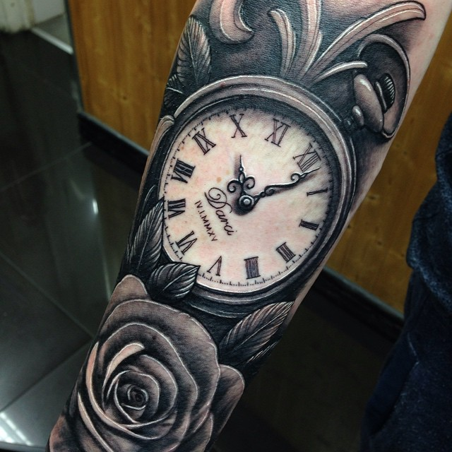 Grey Rose Flower And Pocket Watch Tattoo On Arm
