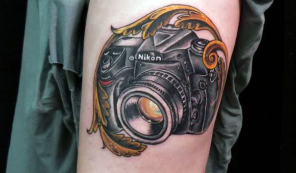 Nikon Camera Tattoo On Left Bicep