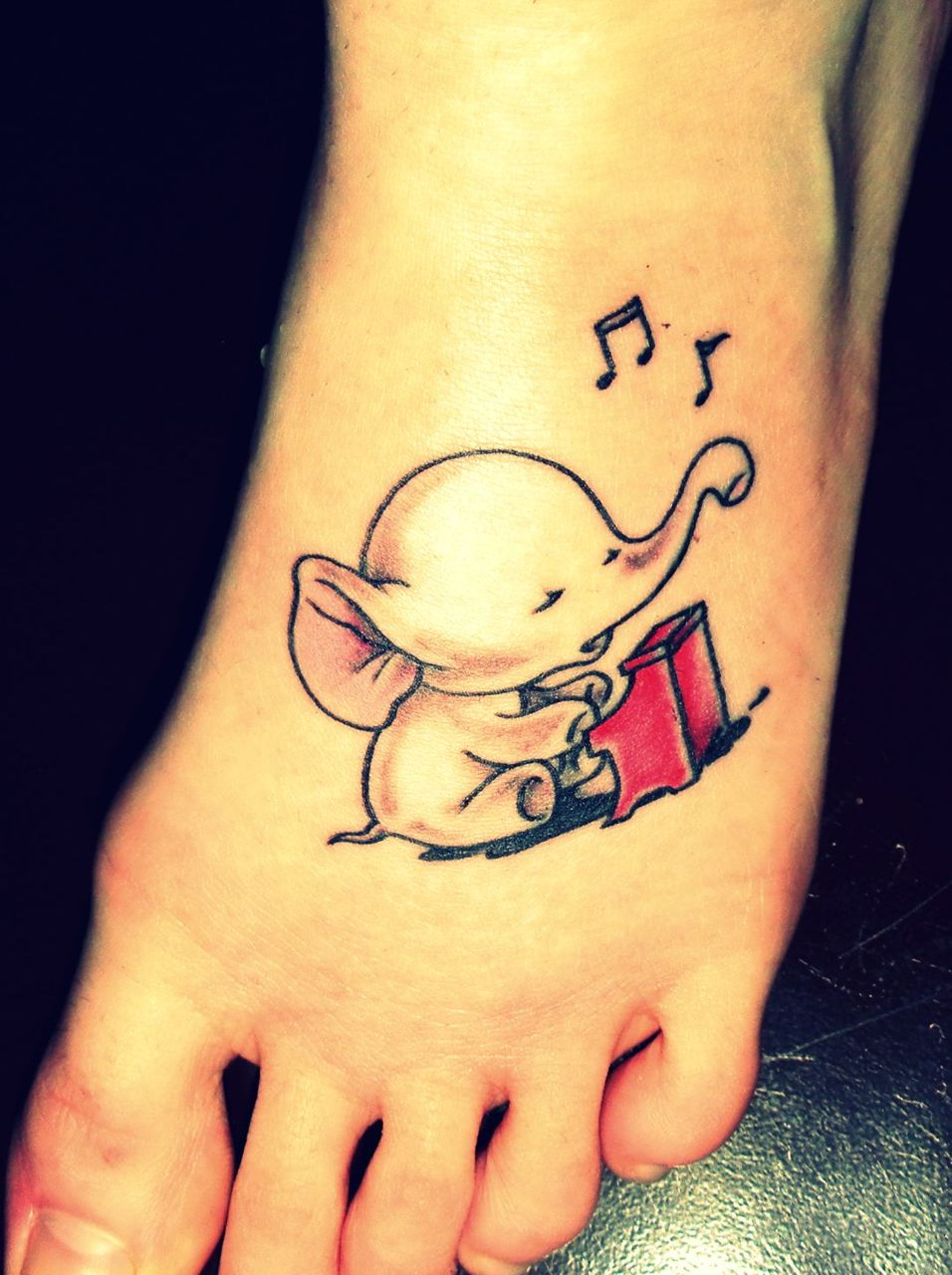 Piano Player Elephant Tattoo On Foot