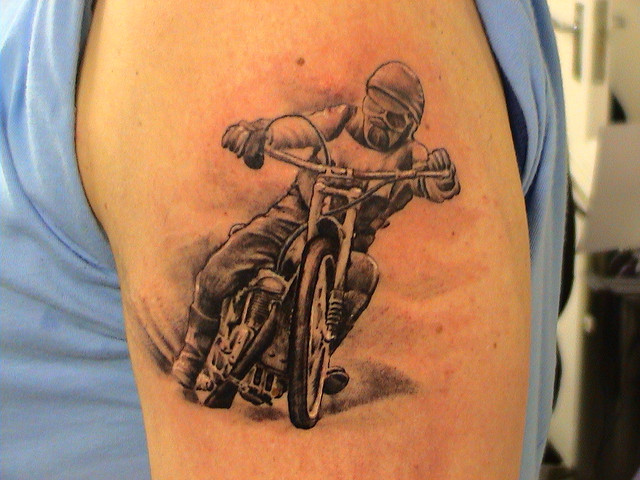 Realistic Bike Rider Tattoo On Left Shoulder