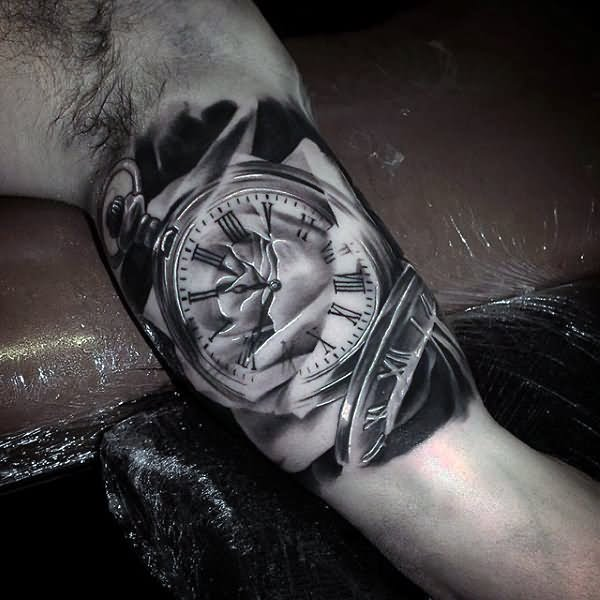 realistic pocket watch tattoo on inner bicep
