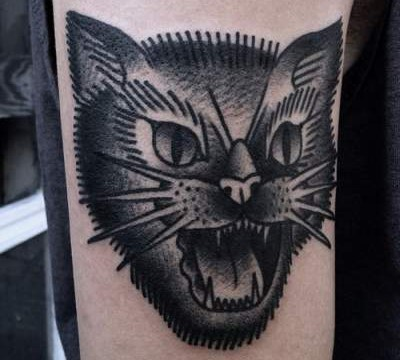 Angry Black Cat Traditional Tattoo On Arm