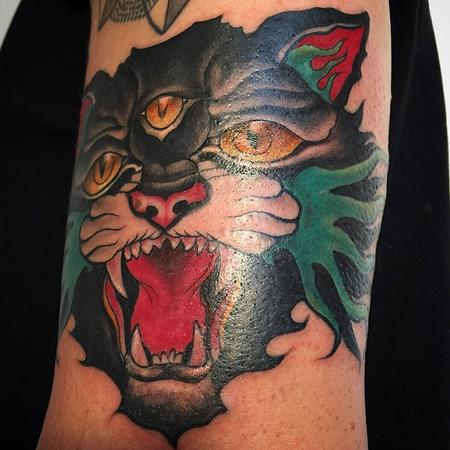 Angry Three Eyed Cat Traditional Tattoo On Arm