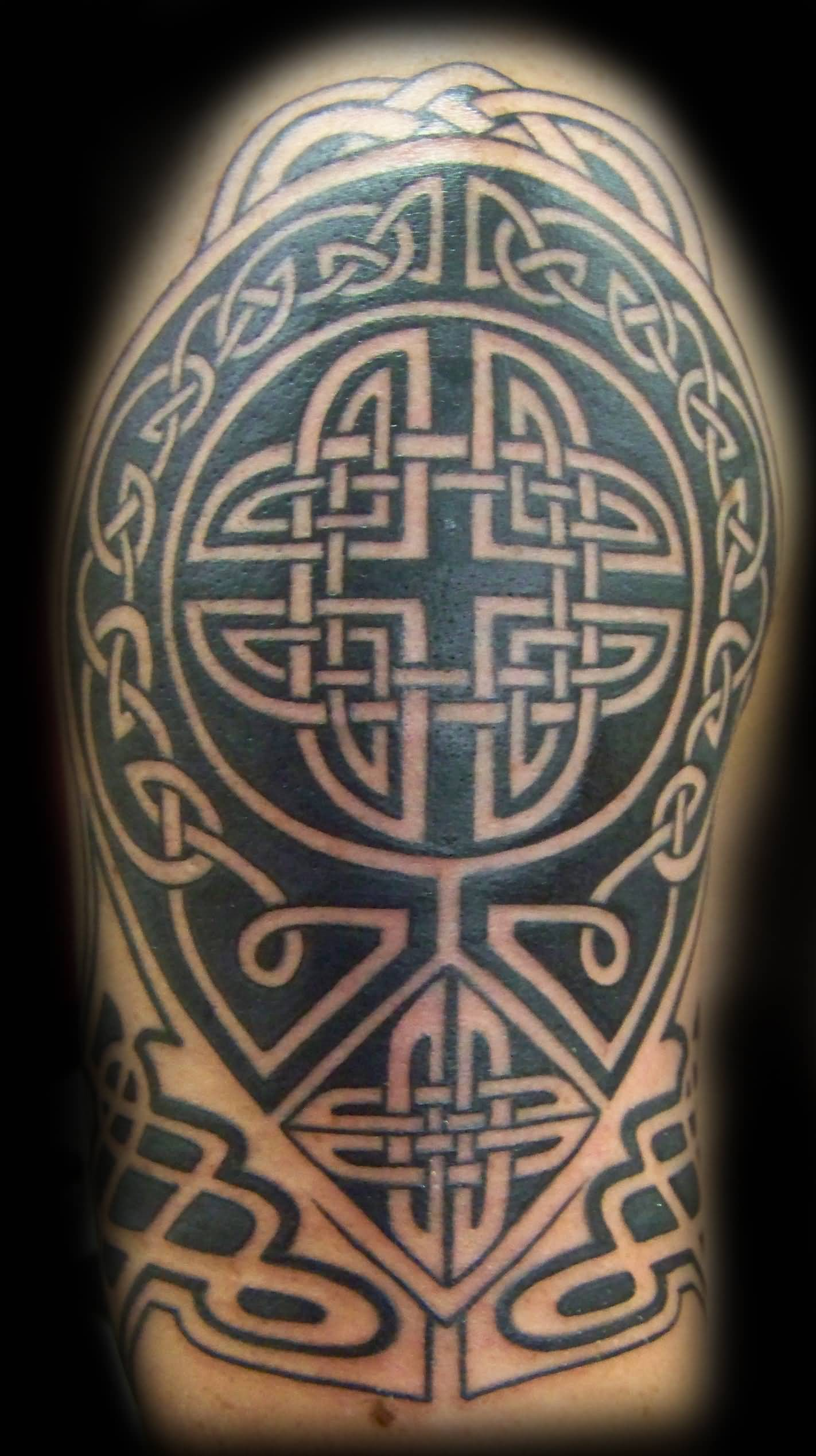 Attractive Black Celtic Tattoo On Half Sleeve