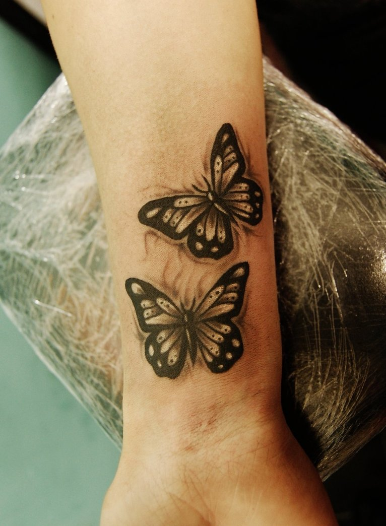 Awesome Butterflies Tattoo On Wrist By Nevermore Ink