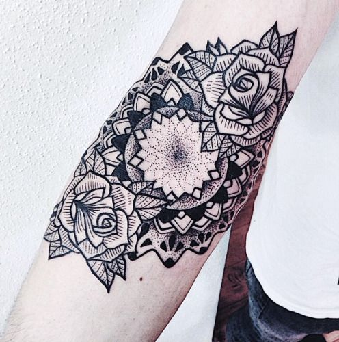 Beautiful linear mandala tattoo on arm