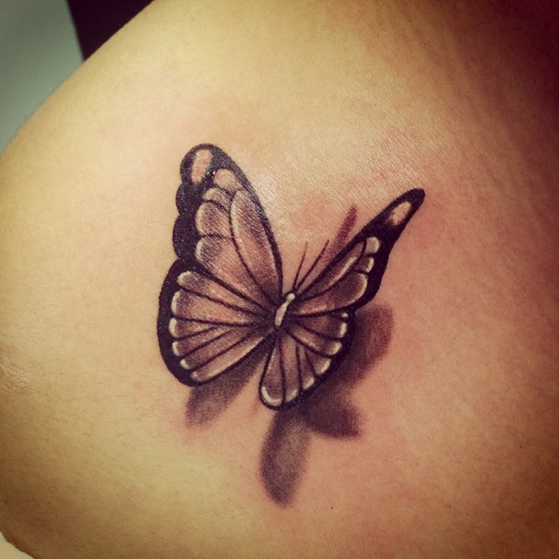 Black Ink Flying Butterfly 3D Tattoo On Shoulder