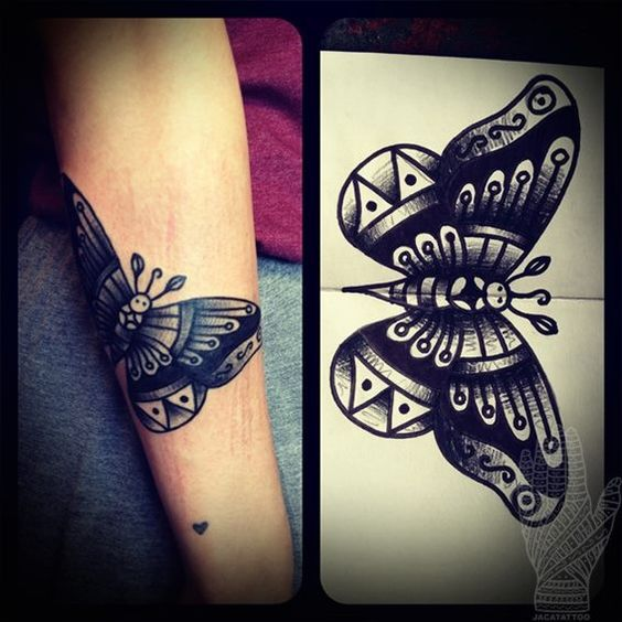 Black Traditional Butterfly Tattoo On Arm