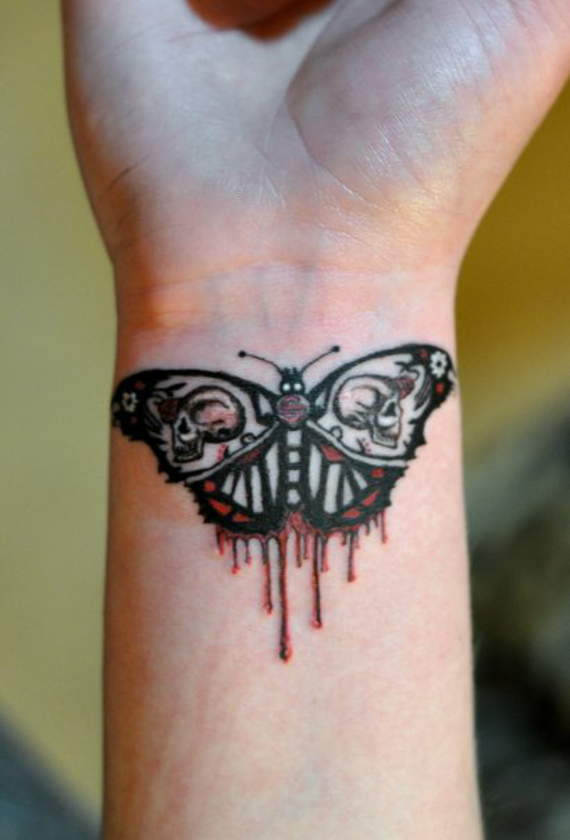 Bleeding Butterfly Tattoo On Wrist