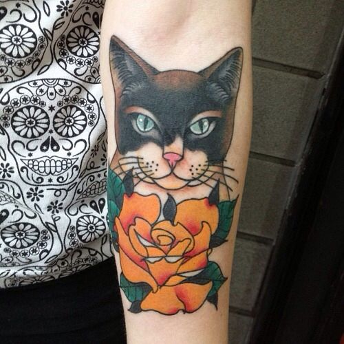 Cat Looking At Flowers Traditional Tattoo On Forearm