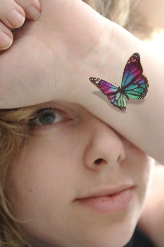 Colorful 3D Butterfly Tattoo On Wrist For Girls