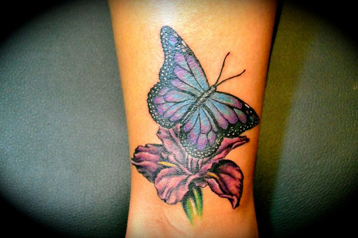 Colorful Butterfly With Flower Tattoo On Wrist