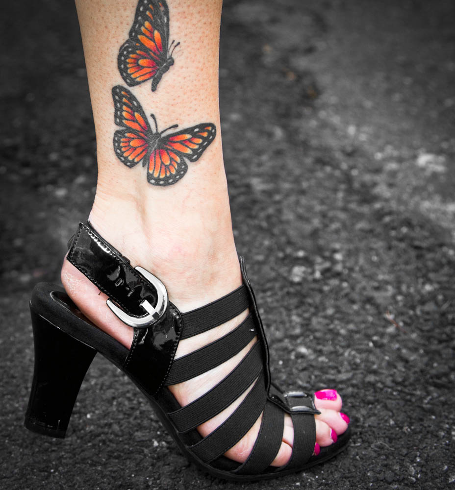 Lovely Monarch Butterflies Tattoo On Girl Ankle