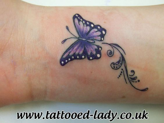 Lovely Purple Butterfly Tattoo On Wrist