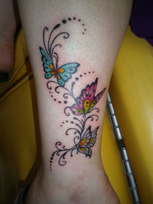 Nice Colored Butterflies Tattoo On Wrist