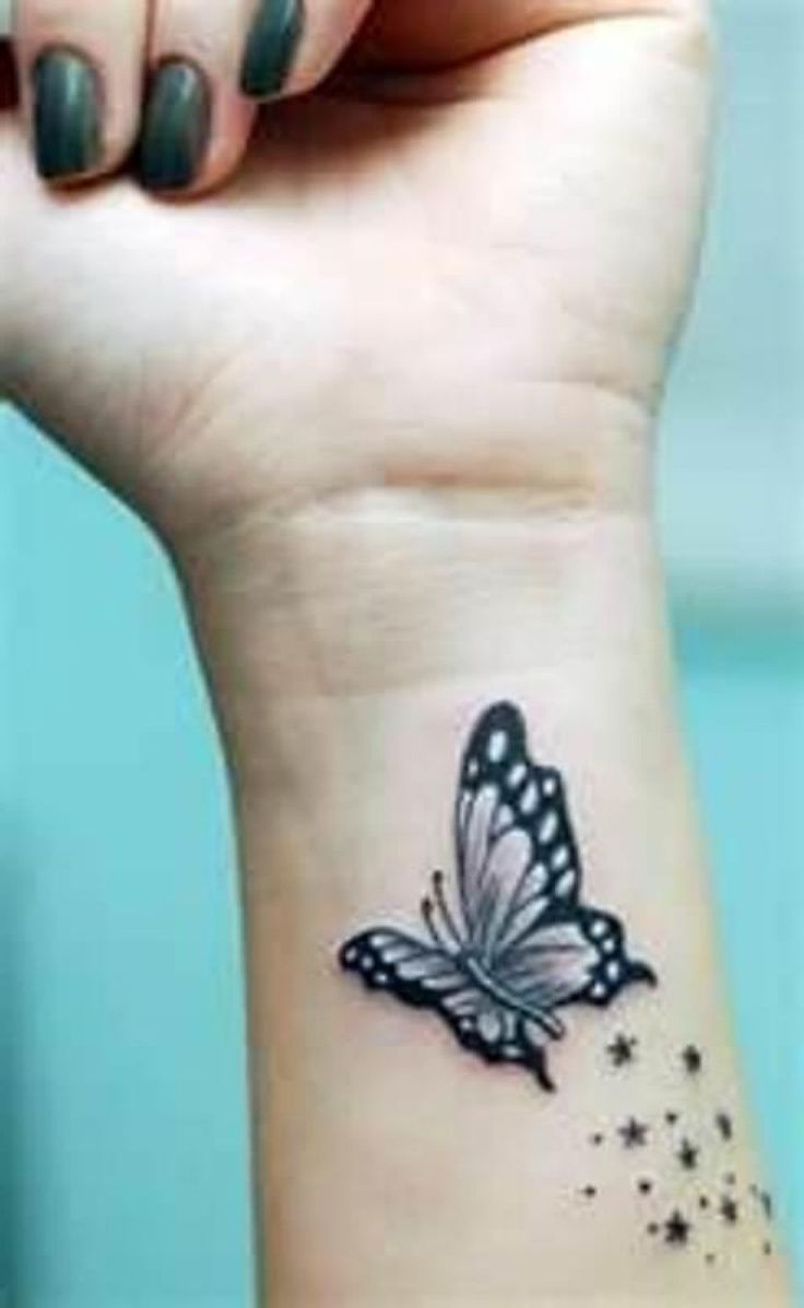 Nice Stars With Butterfly Tattoo On Girl Wrist