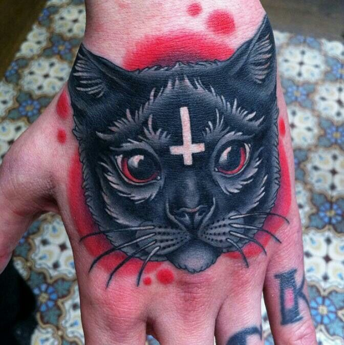 Religious Cat Tattoo On Hand By Megan Massacre