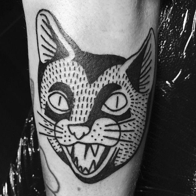 Simple Linework Traditional Cat Head Tattoo