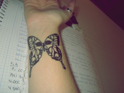 Skull Butterfly Tattoo On Wrist For Girls