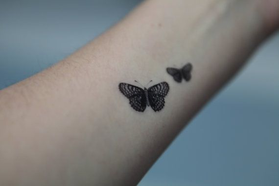 Tiny Black Butterfly Tattoo On Forearm