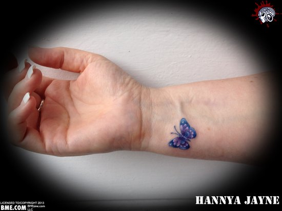 Tiny Blue Butterfly Tattoo On Wrist