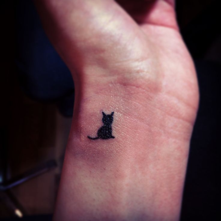 97b7f3abaed9a Tiny Cat Silhouette Tattoo On Wrist