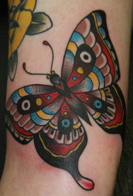 Traditional Butterfly Tattoo On Arm